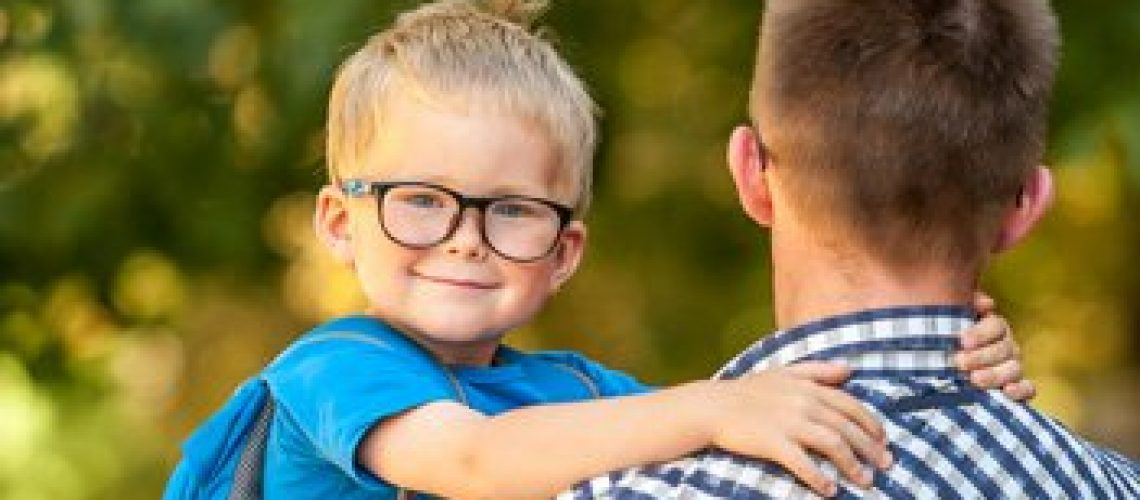 boy-glasses-carried-by-man-350